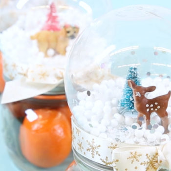 This DIY mason jar snow globe contains a holiday surprise—and it smells like a hygge dream