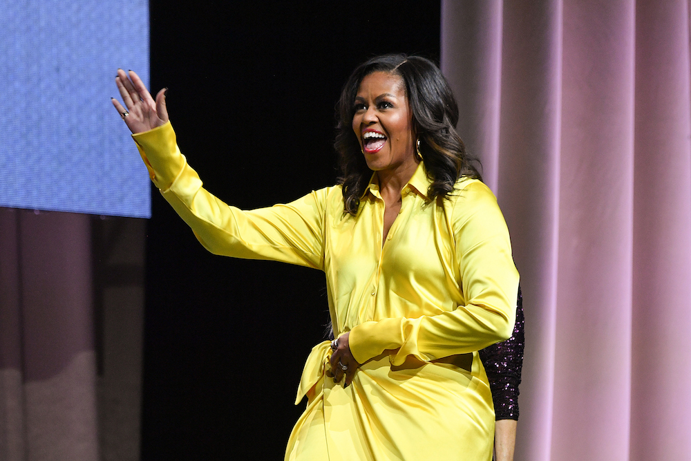Michelle Obama dazzled in gold sequin thigh-high boots, and this is serious New Year's Eve inspo
