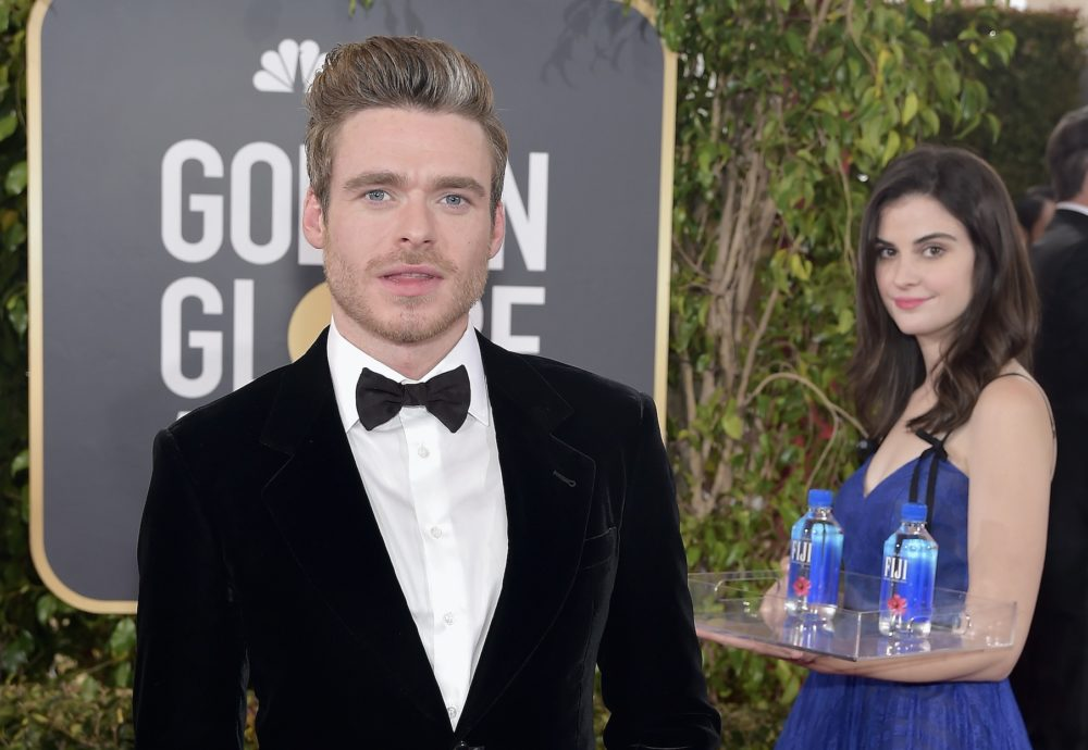 "The internet is obsessed with the ""water girl"" who photobombed tons of Golden Globes photos"
