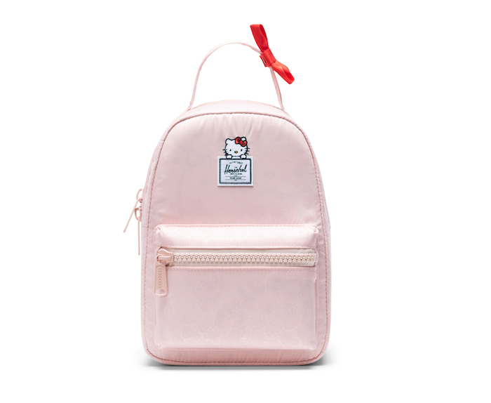 af056178b0fc Courtesy of Sanrio.  54.99 Herschel Supply SHOP IT. A tiny pink Hello Kitty  ...