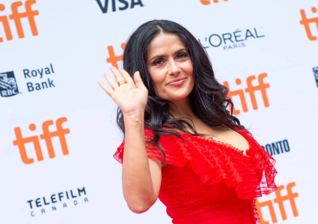 "Salma Hayek shared a makeup-free selfie to show she's ""proud"" of her naturally graying hair"