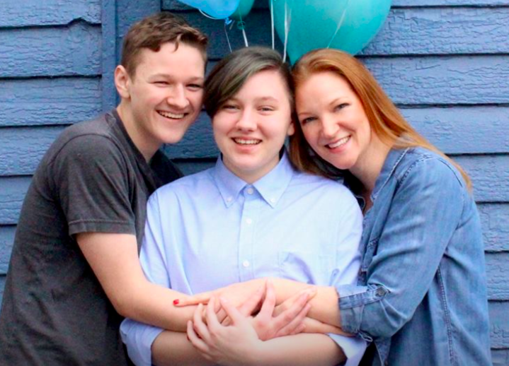 A trans man's mom threw him a belated gender reveal party, and these photos are pure joy