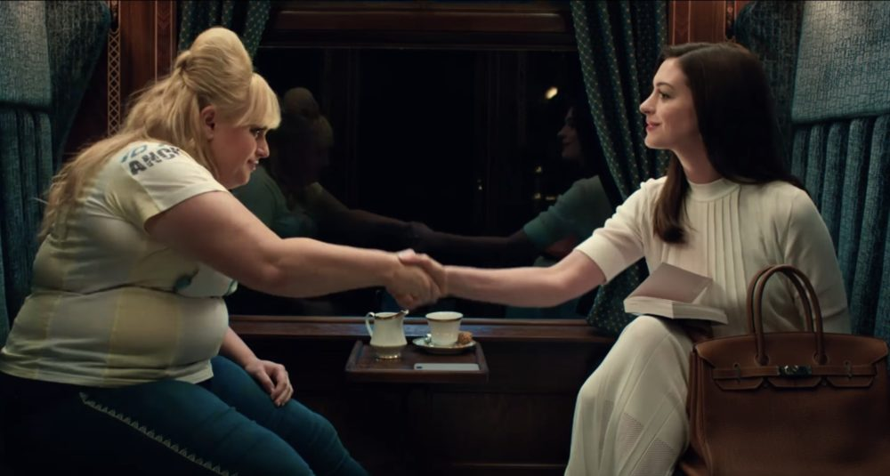 Here are the most badass feminist lines from the trailer for the new Anne Hathaway/Rebel Wilson comedy