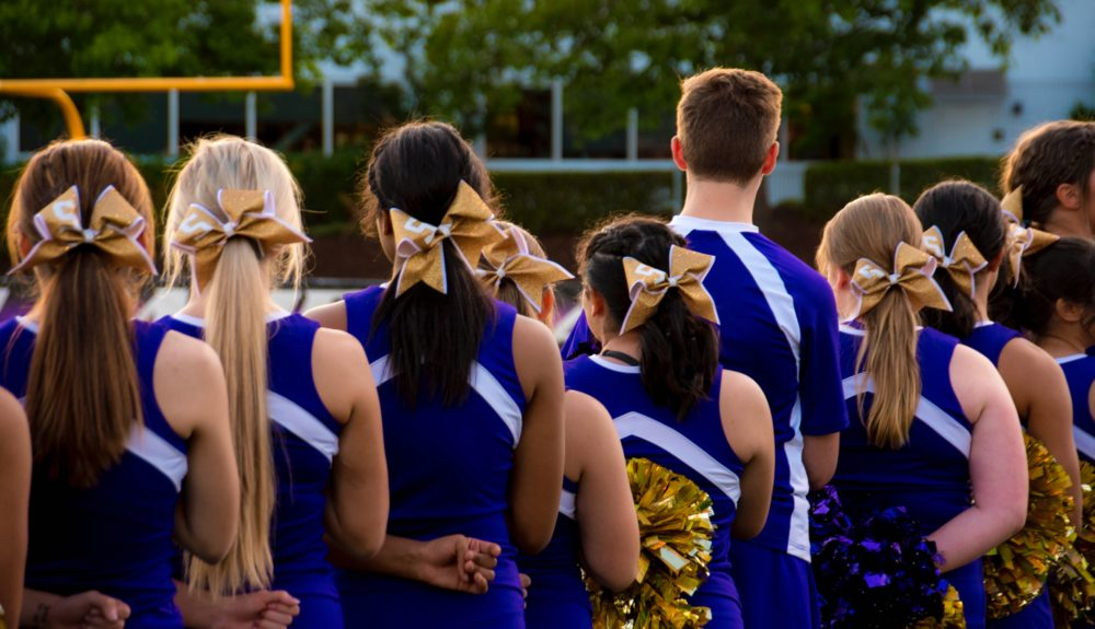 "High school cheerleaders were given ""awards"" for things like ""best booty"" from their <em>coaches</em>—and it's not okay"