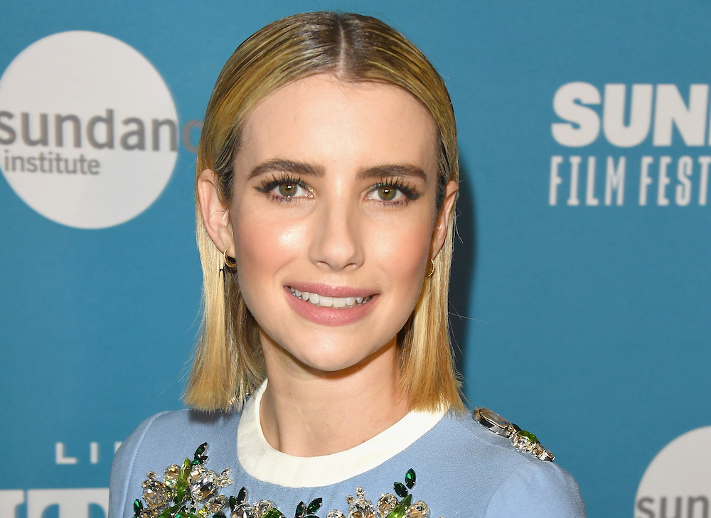 Emma Roberts is back to being a brunette, and we swear she can pull off any hair color
