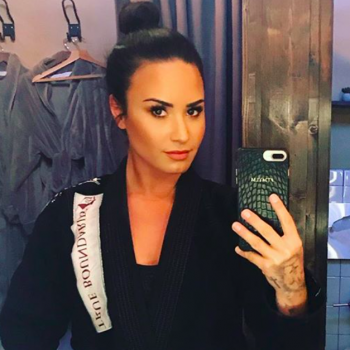 Demi Lovato knocked her boxing trainer's tooth out, and when is this badass chick's first fight?