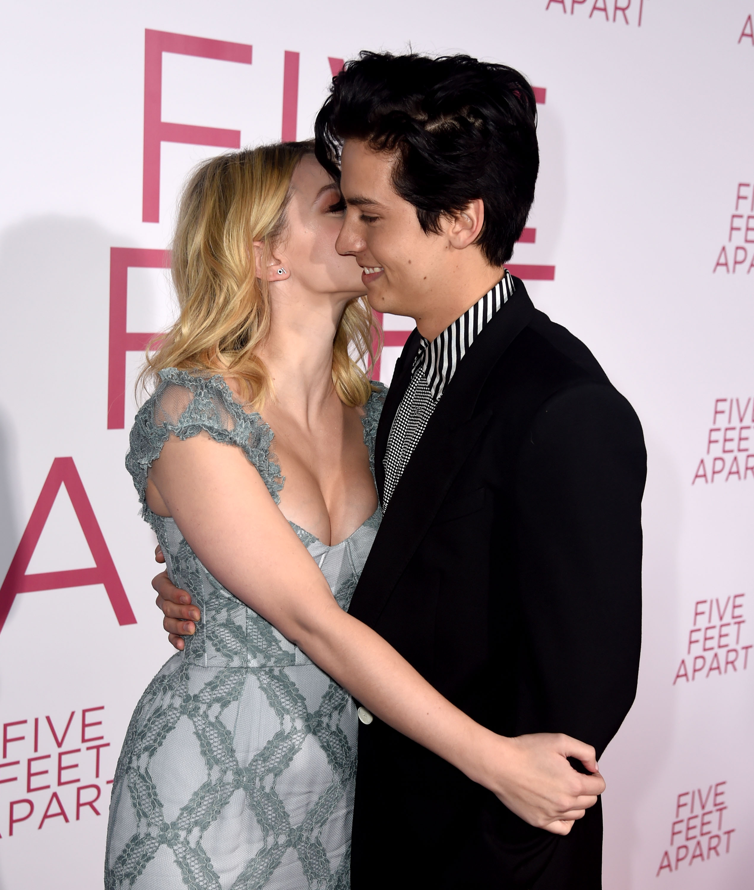 Lili Reinhart And Cole Sprouse Showed Rare PDA On Red