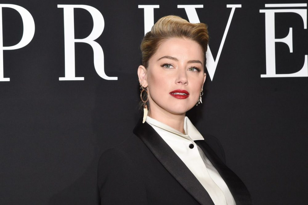 "Amber Heard revealed what it was like to tell her parents she was in love with a woman—""It was just tears, tears"""