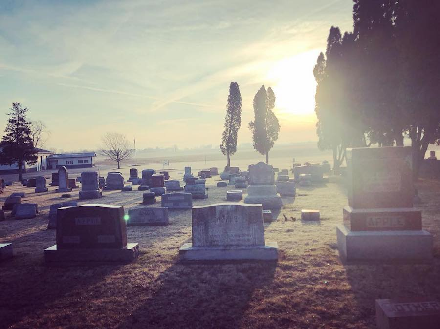Photo of headstones in cemetery by author