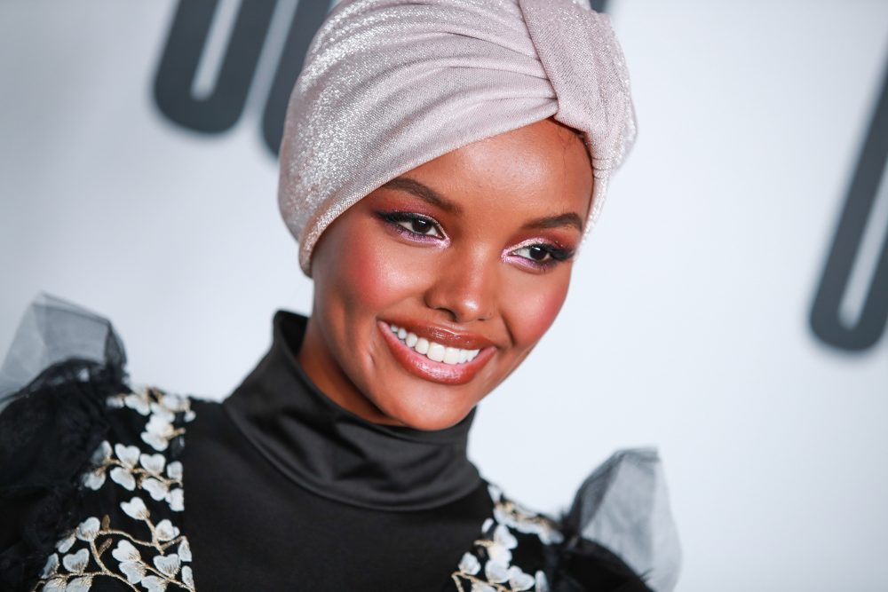 Halima Aden is the first woman to rock a hijab and burkini in the Sports Illustrated Swimsuit Issue, and the photos are stunning