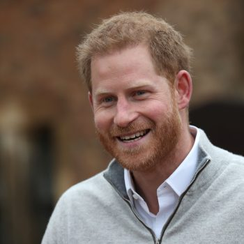 Prince Harry giddily announcing he's a dad during a press conference is officially a MOOD