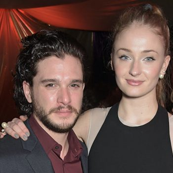 """We're weirdly obsessed with watching Kit Harington cry—while Sophie Turner laughs at him—in this BTS """"GoT"""" footage"""