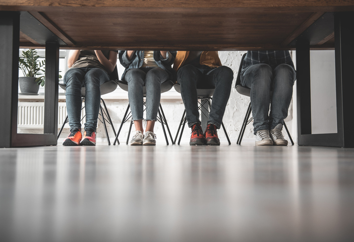 People sitting at table in focus group