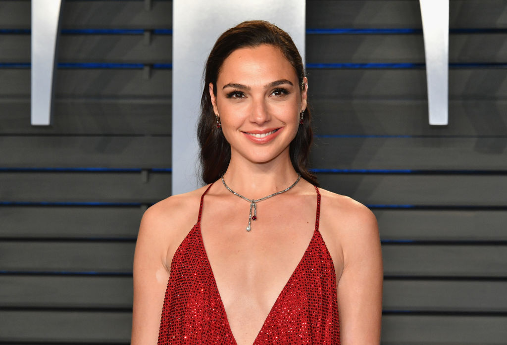 Gal Gadot unveiled a new <em>Wonder Woman 1984</em> poster, and her costume looks COMPLETELY different