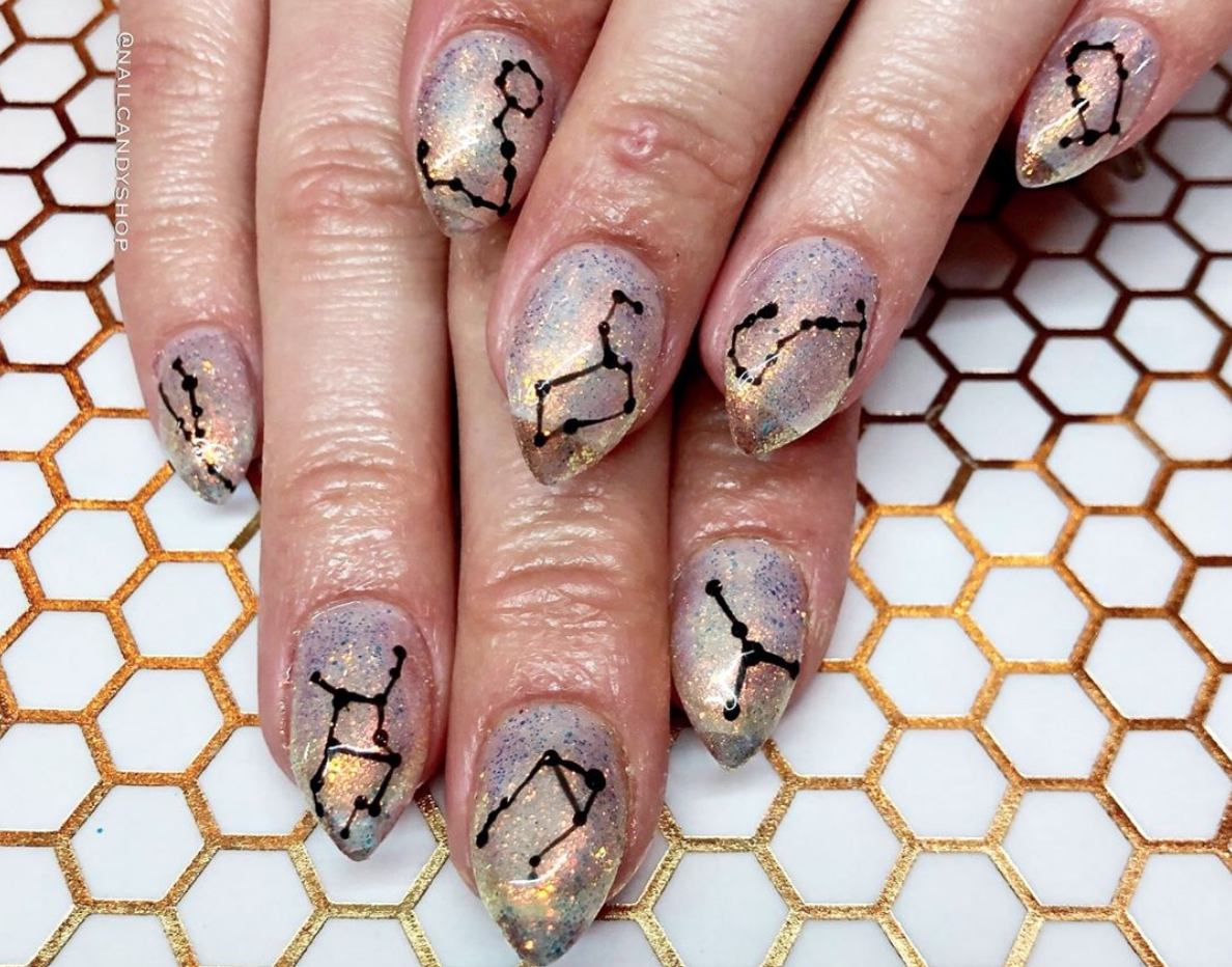 Constellation nails are the dreamy nail art trend that will take your manicure to the next galaxy