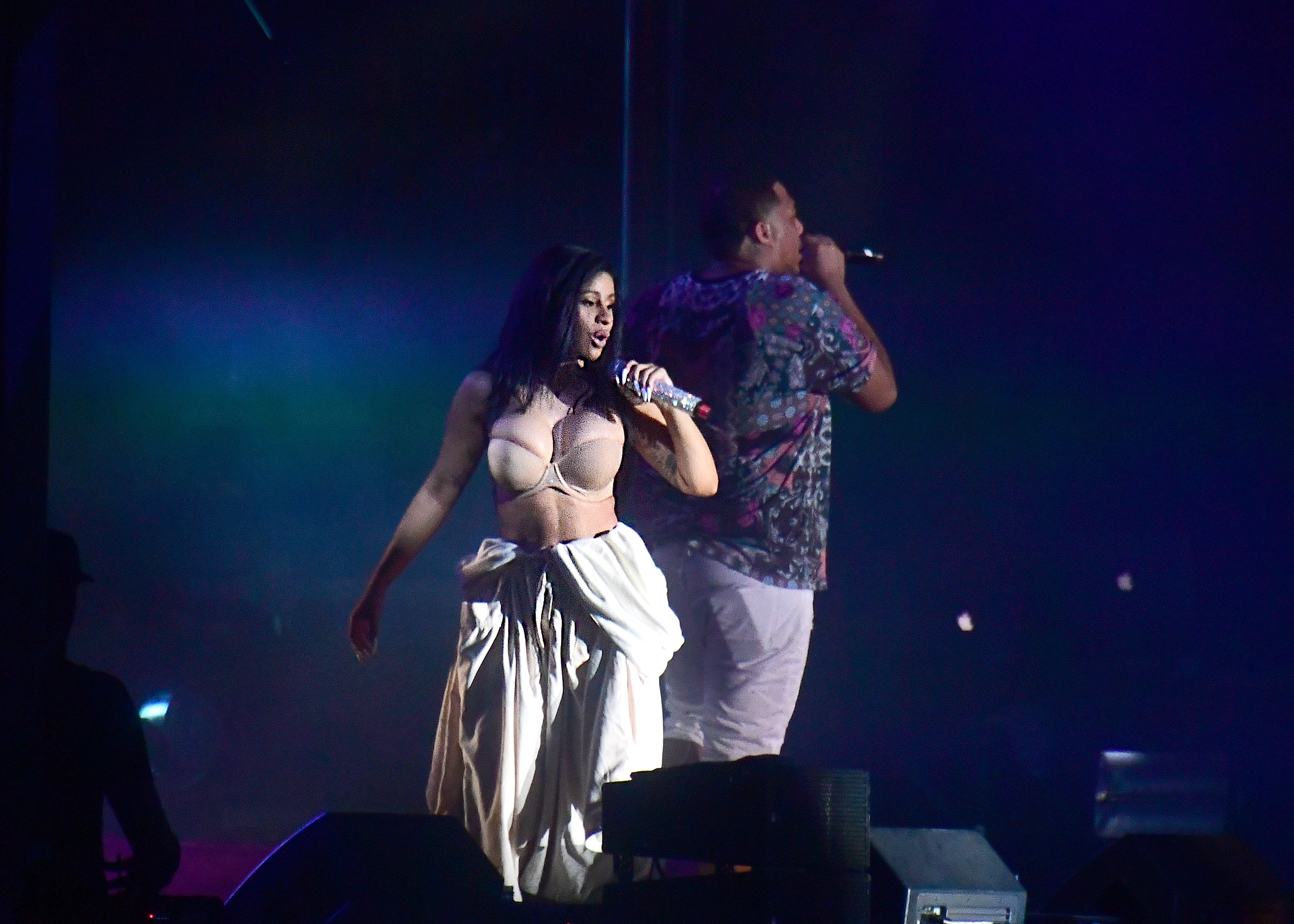 Cardi B wearing a bathrobe at Bonnaroo 2019.