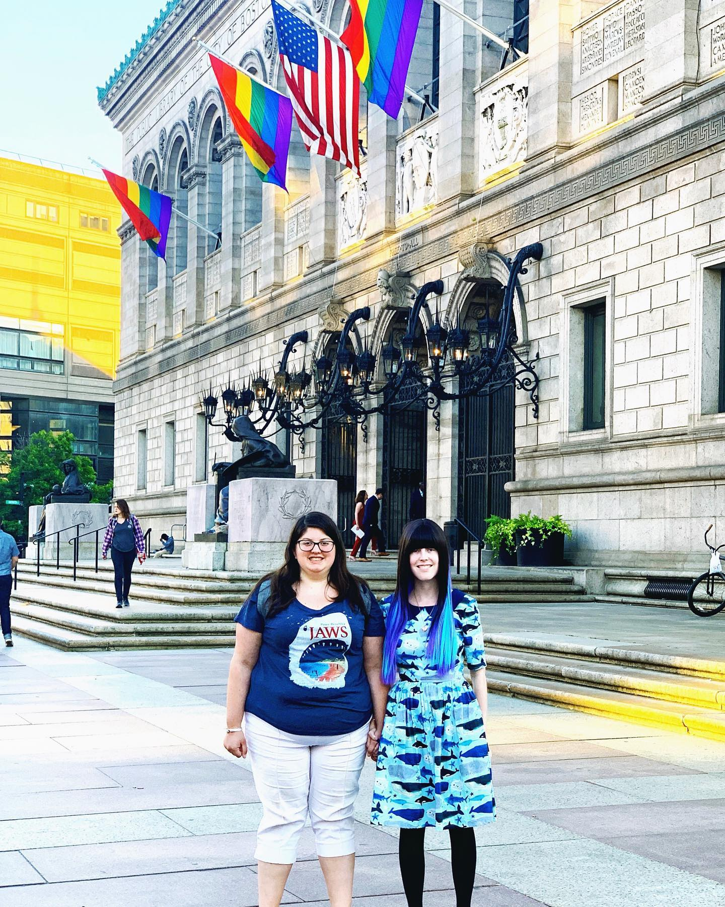 Author and her fiancee in front of building with pride flags
