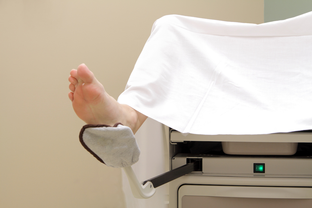 Woman's feet in stirrups at the gyno