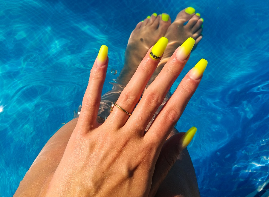 Grab your sunglasses because bright neon ombré nails are up 904% on Pinterest