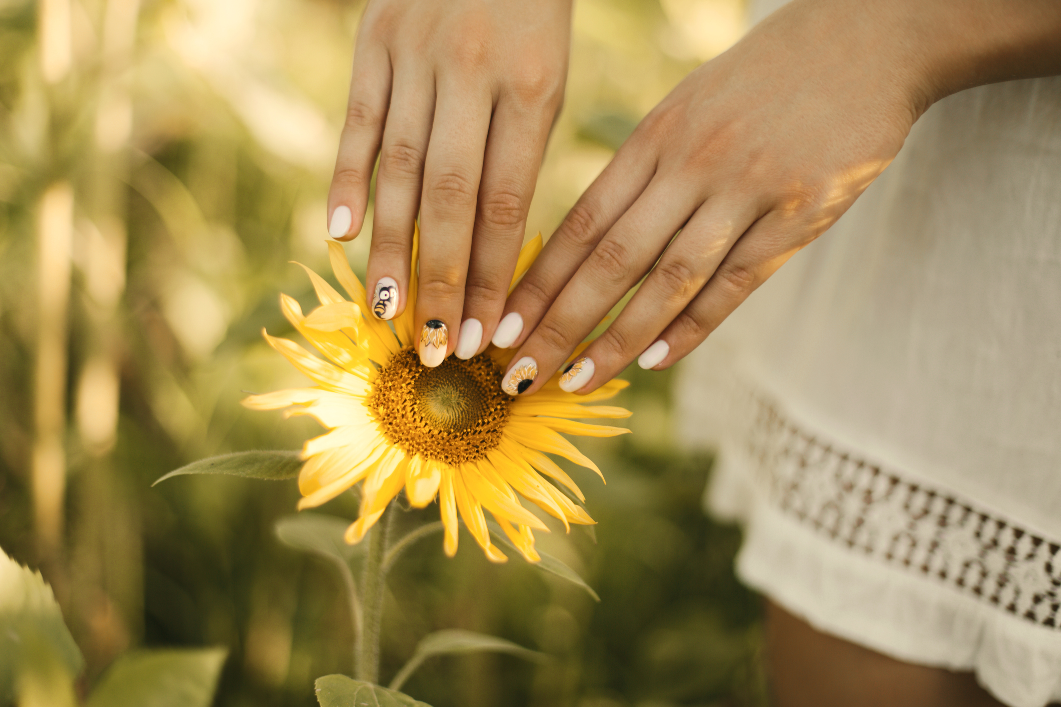 Sunflower nails are the peak summer mani trend you need on your fingertips