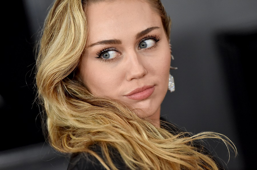 "Miley Cyrus's new song ""Slide Away"" feels like an explainer on her Liam Hemsworth breakup"