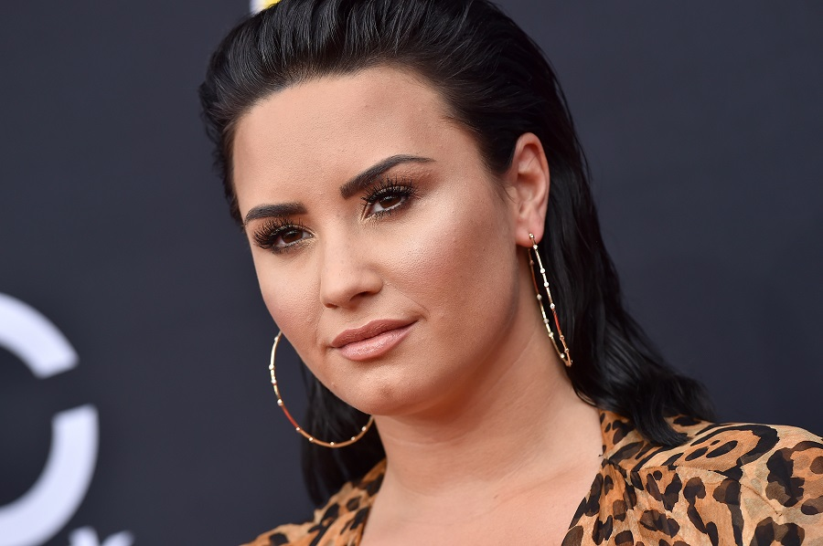 Demi Lovato will channel her <em>Camp Rock</em> days in a new Will Ferrell movie musical