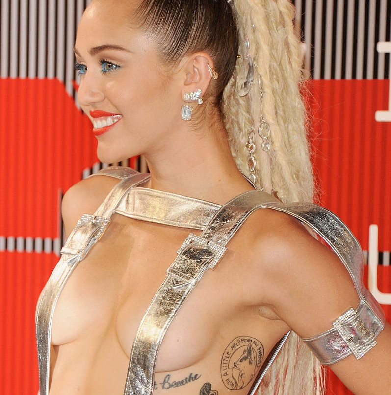 Miley Cyrus's new song lyric tattoo feels VERY relevant to her Liam Hemsworth breakup