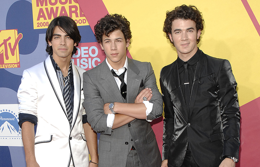 We're throwing it back to these stars' first MTV VMAs, and their transformations are hilarious