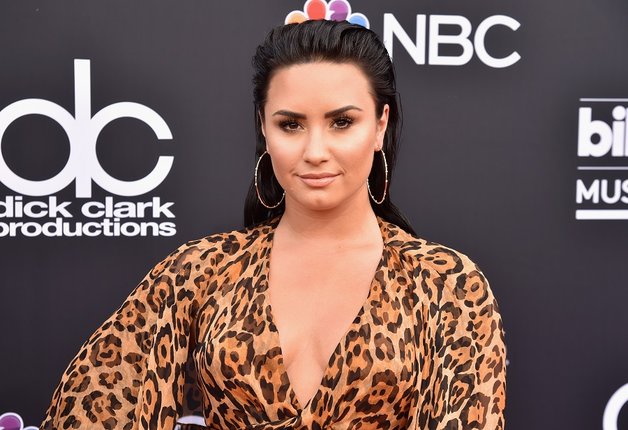 "Demi Lovato shared an unedited bikini photo because she's ""tired of being ashamed of"" her body"
