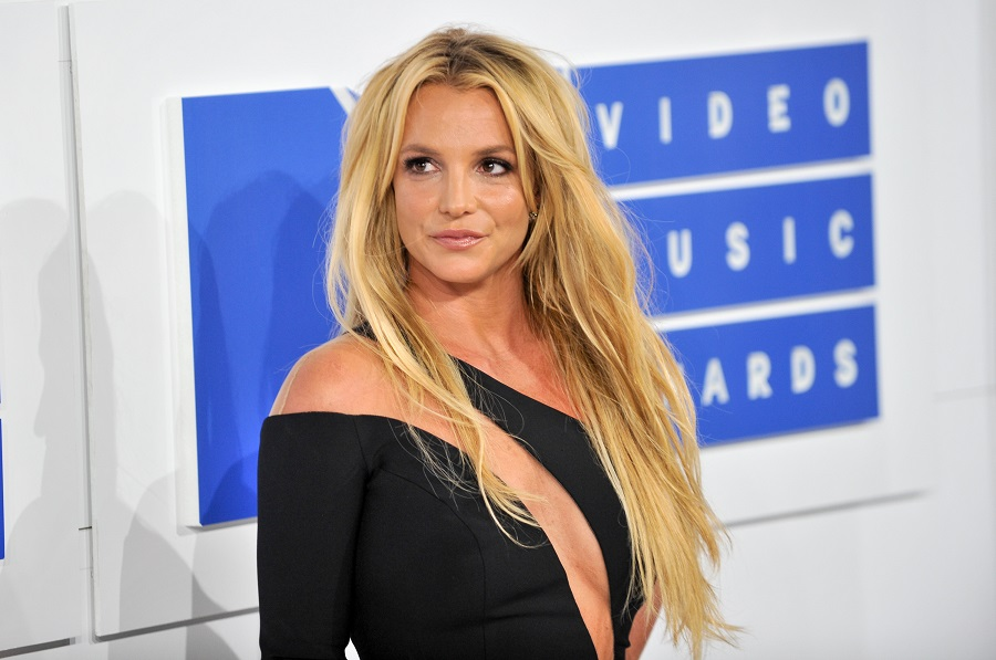 "Britney Spears just went brunette, and it feels like a ""Gimme More"" throwback"