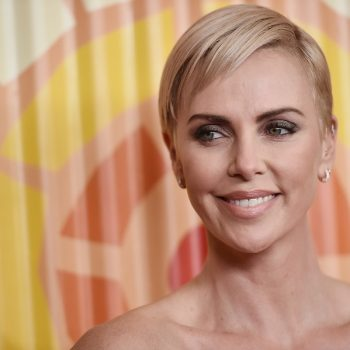 Charlize Theron says she was criticized for gaining weight and not smiling in her most iconic role