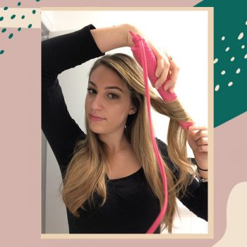 A step-by-step guide to curling your hair with a flat iron, according to pro stylists