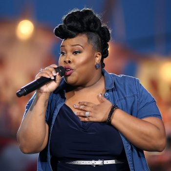 Watch <em>Glee's</em> Amber Riley sing an emotional Beyoncé song while protesting